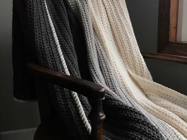 Gray Ombre half double crochet blanket draped on a chair