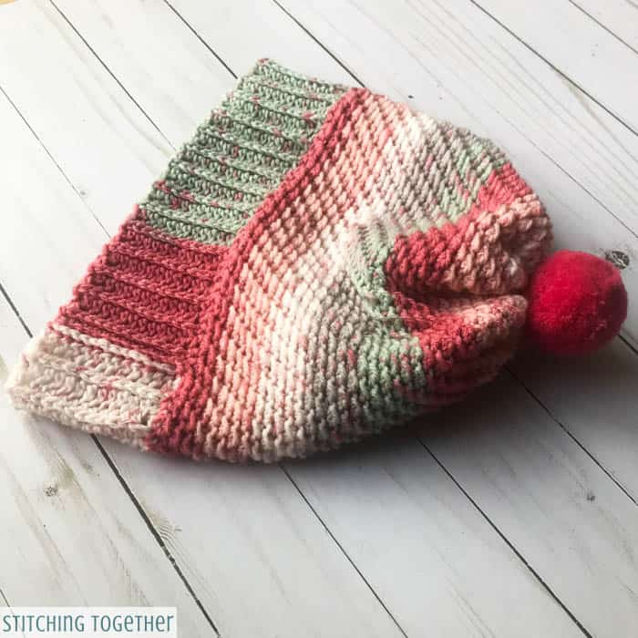 striped crochet hat with brim and pom pom