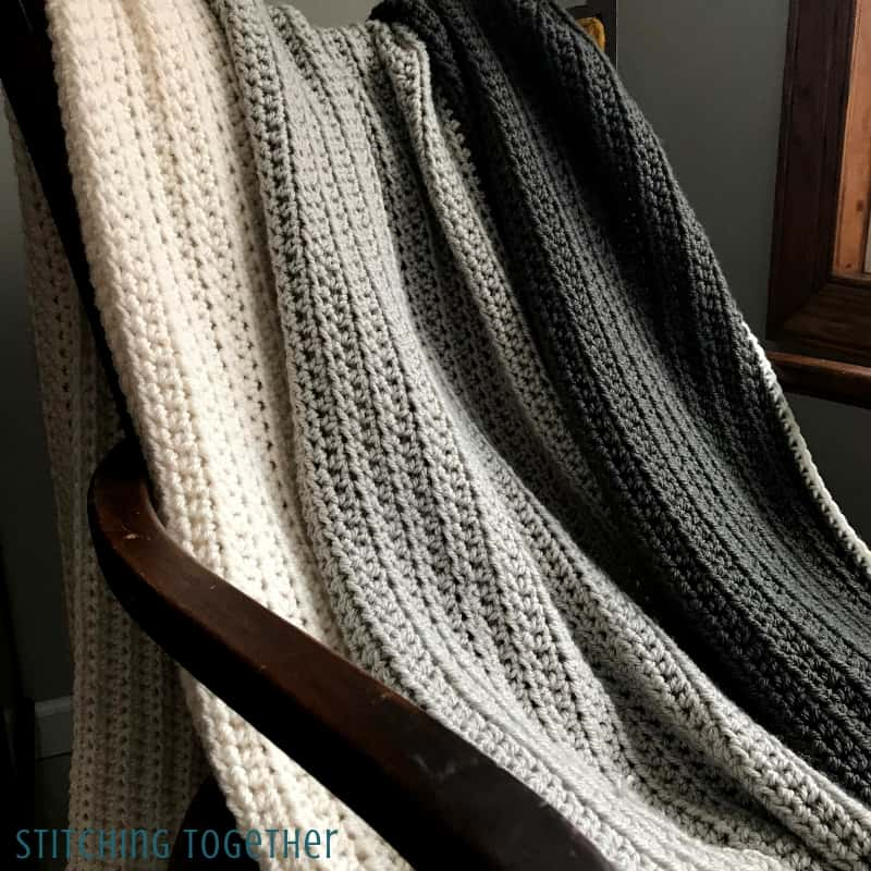 half double crochet throw blanket draped on chair