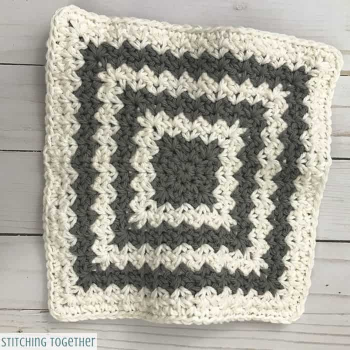 gray and white crochet trivet hot pad before blocking