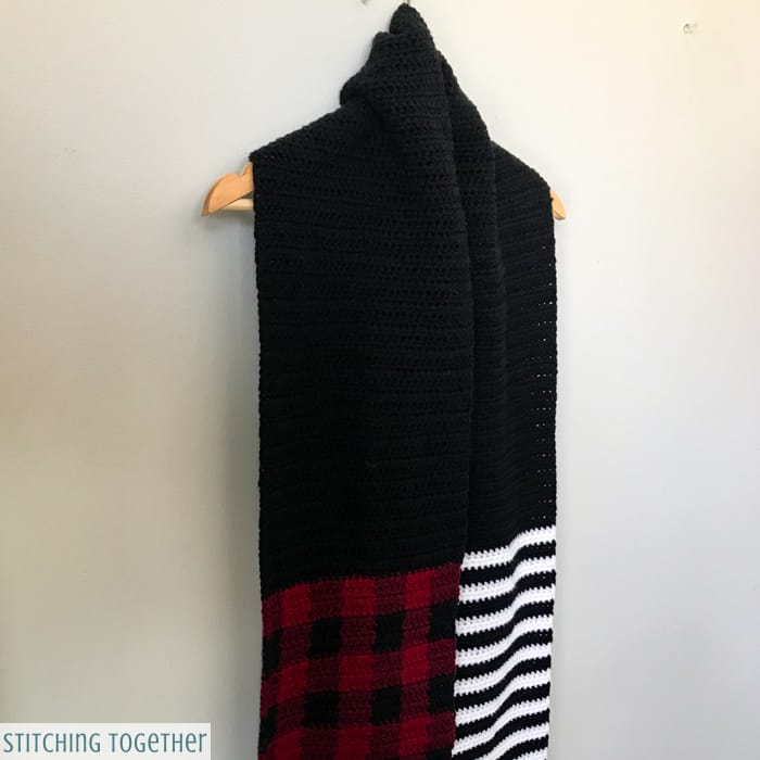 black and white striped crochet scarf with buffalo plaid and black