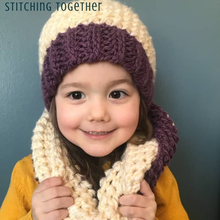 girl wearing chunky crochet scarf and hat