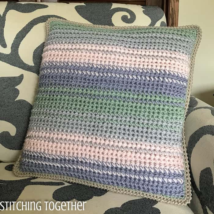 striped crochet pillow cover on chair