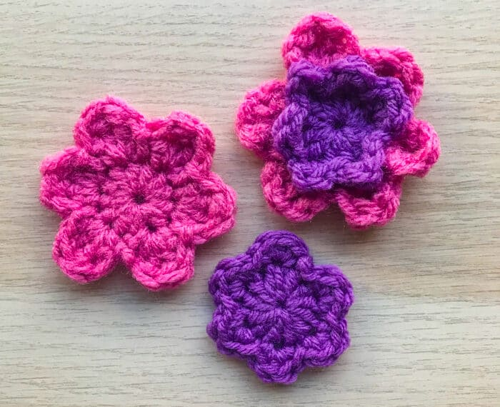 pink and purple crochet flowers on with double petals