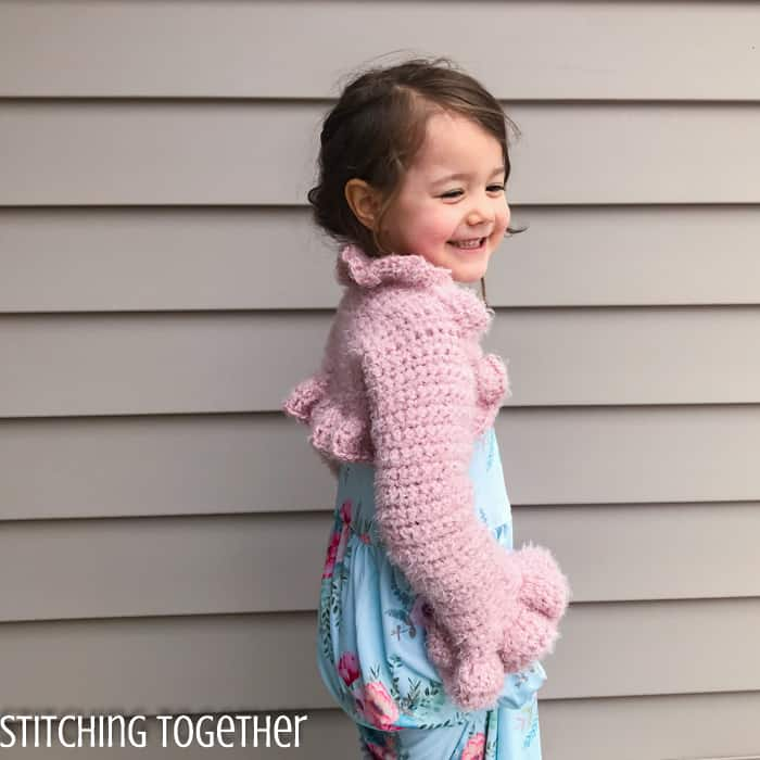 girl wearing pink crochet bolero with ruffles