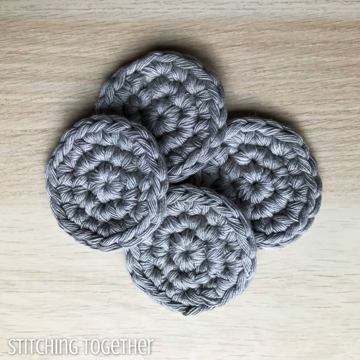 four gray round crochet crochet facial cleansing pads