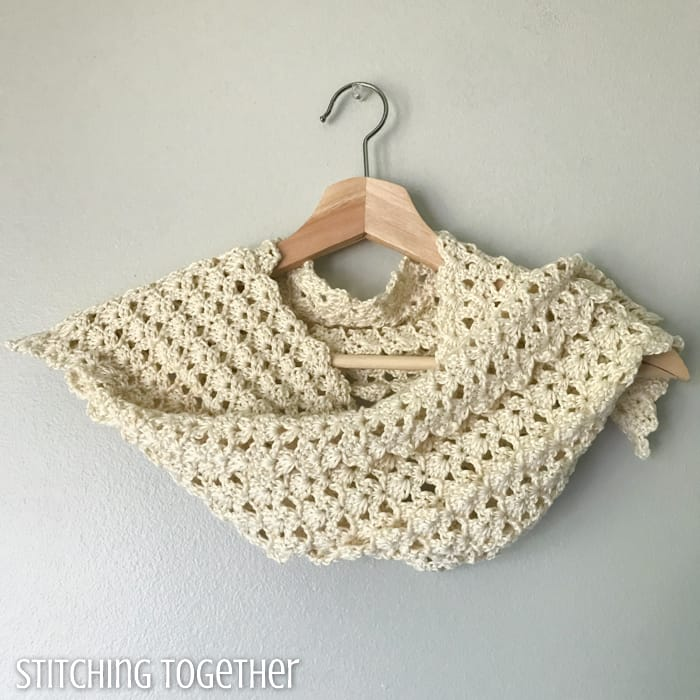 crochet lacy scarf wrapped on a hanger