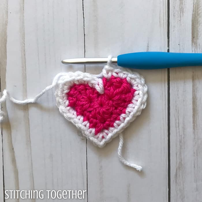 adding a white round to a pink crochet heart