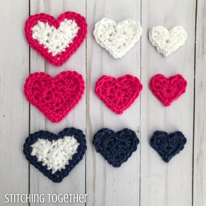 pink, blue and white crochet hearts lined up