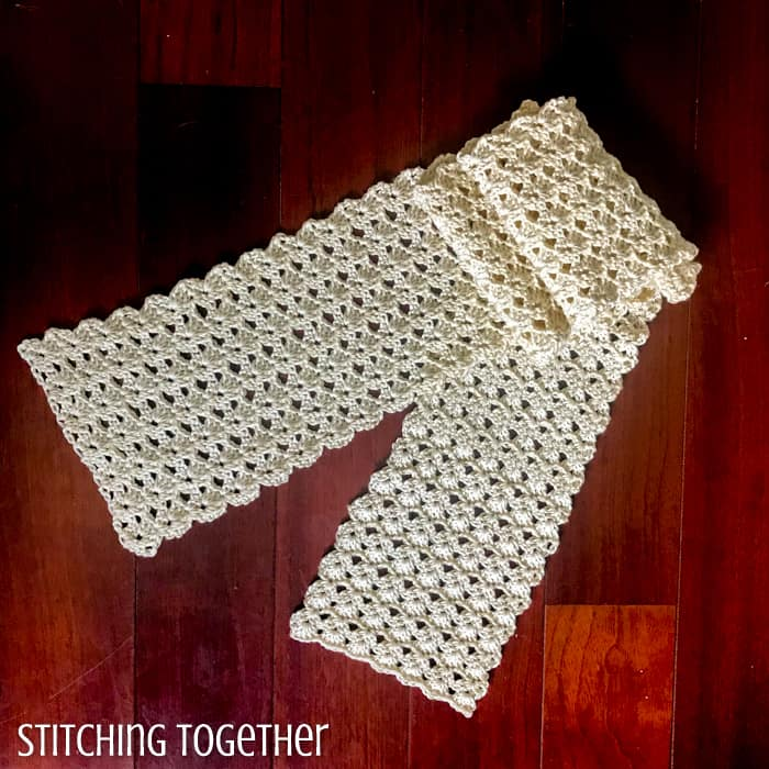 ivory colored lacy crochet scarf folded