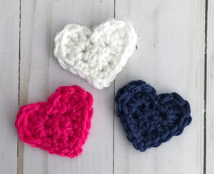 pink blue and white small crochet hearts