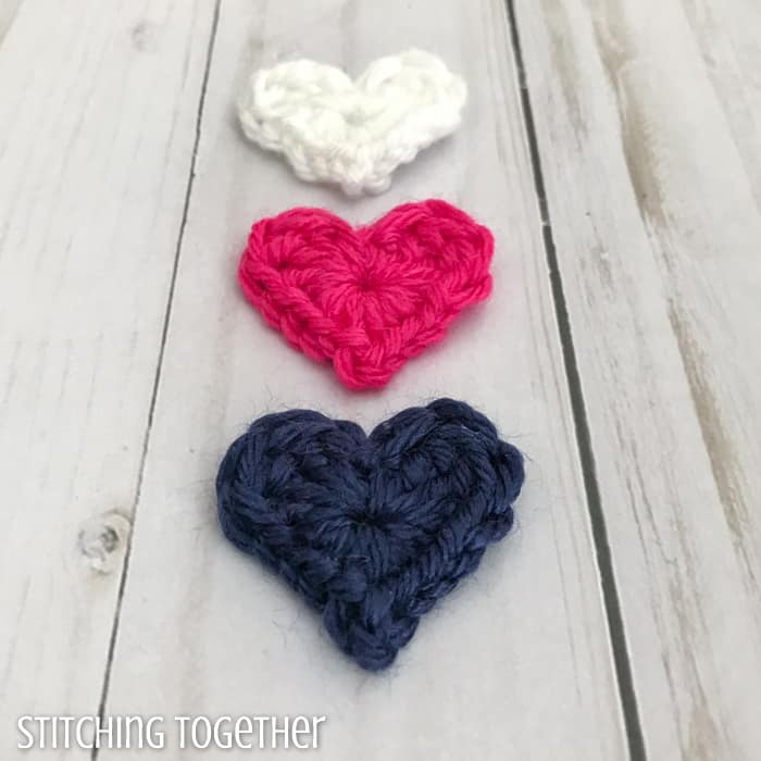 3 tiny crochet hearts in a line