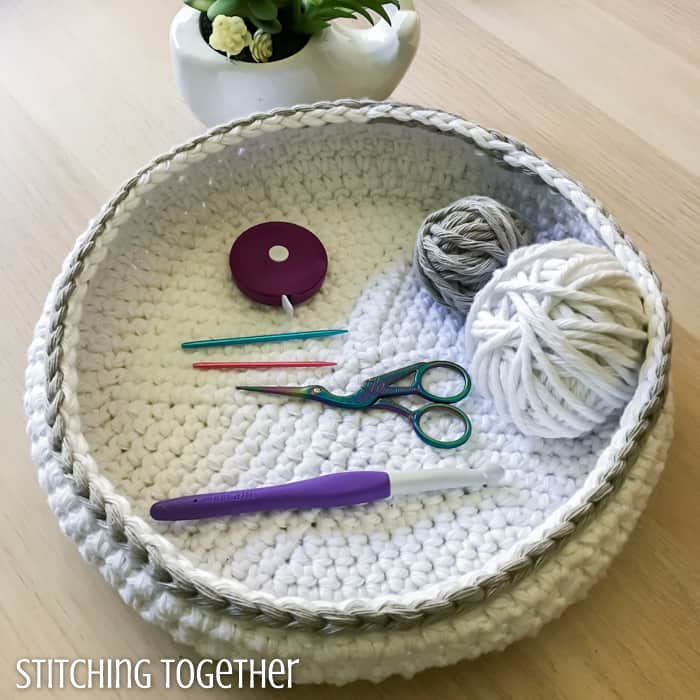white crochet bowl with crochet tools inside