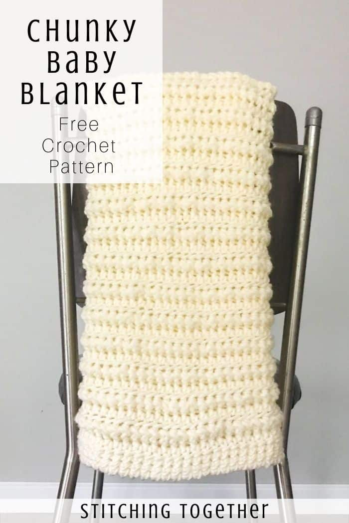 crochet baby blanket hanging on the back of the chair