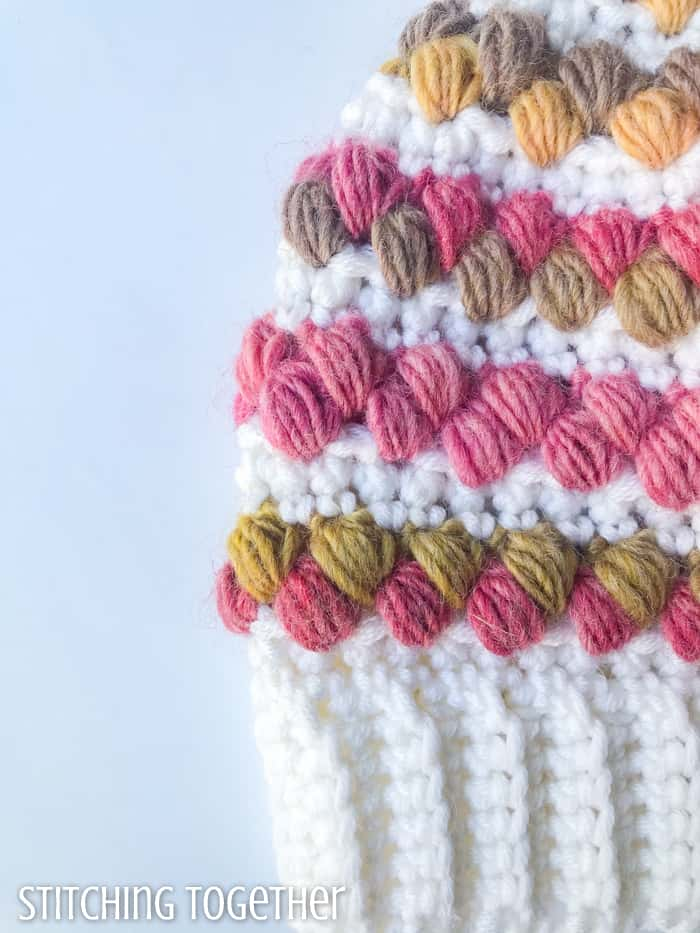 colorful puff stitches on crochet fabric