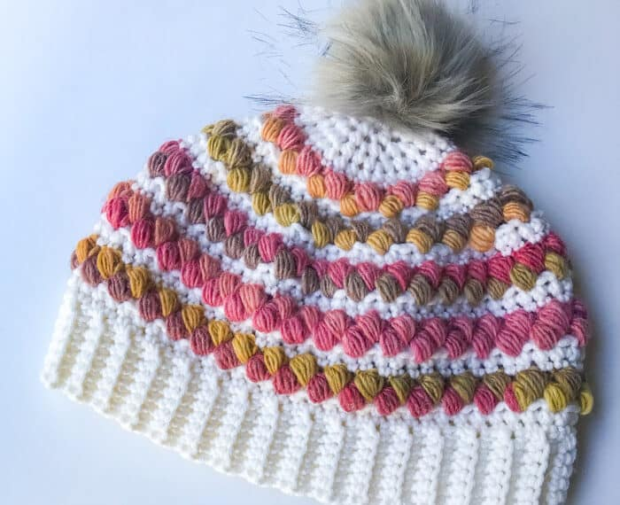 crochet women's hat with colorful puff stitches and pom pom
