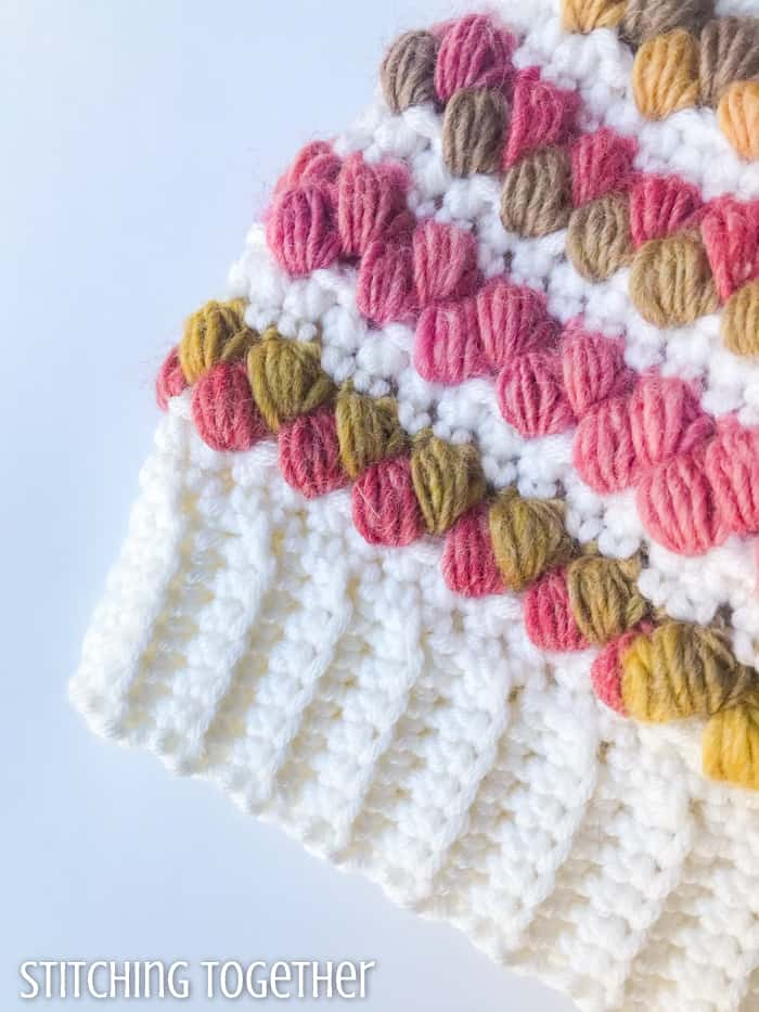 close up of crochet hat band with colorful puff stitches