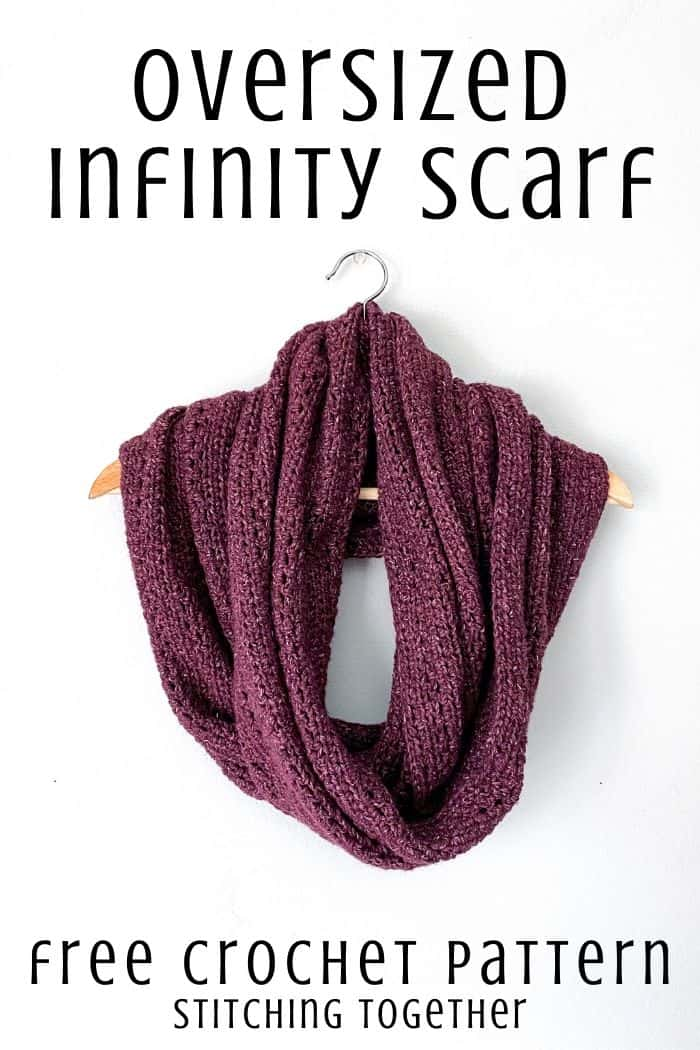 Oversized infinity scarf free crochet pattern pin image with scarf draped on a hanger