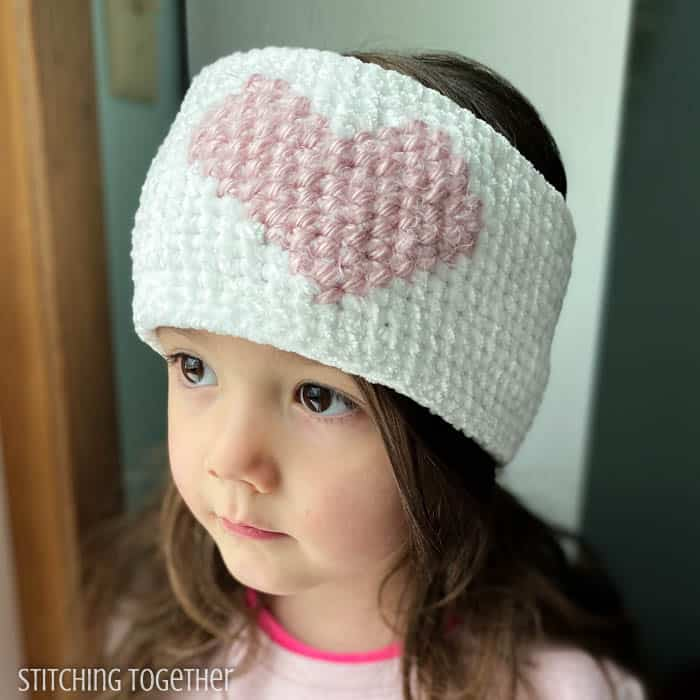 girl wearing crochet heart headband