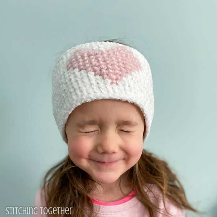 girl wearing heart crochet headband