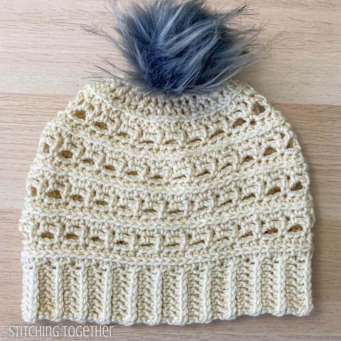 woman crochet beanie with pom pom