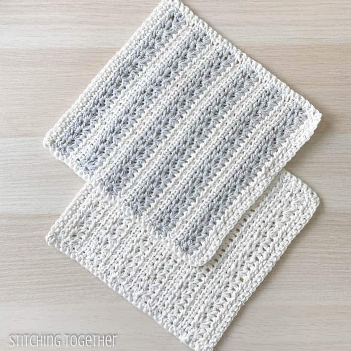 two textured crochet dishcloths laying flat