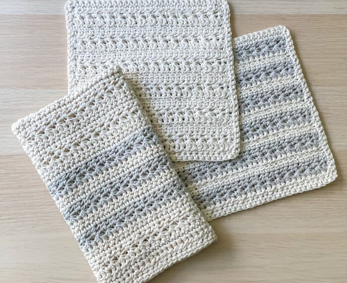 folded crochet kitchen towel and matching dishcloths