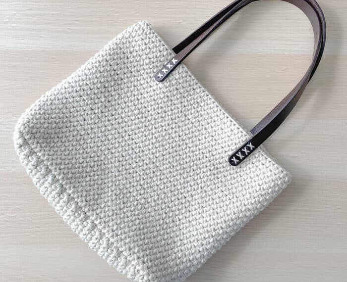 cream crochet shoulder bag with leather handles