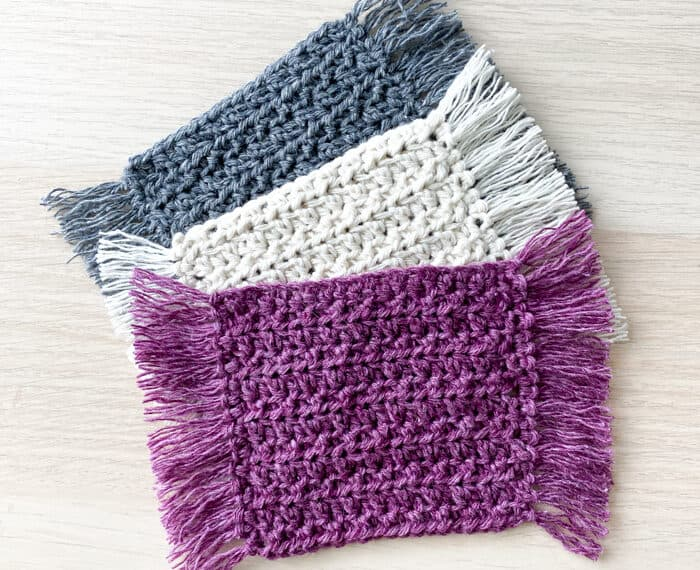 3 crochet coasters with fringe