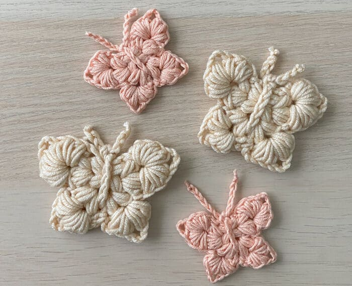 4 crochet butterflies in neutral colors