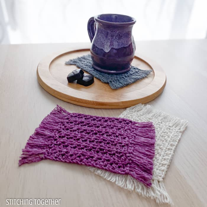 mug sitting on a crochet coaster with 2 other coasters stack in front