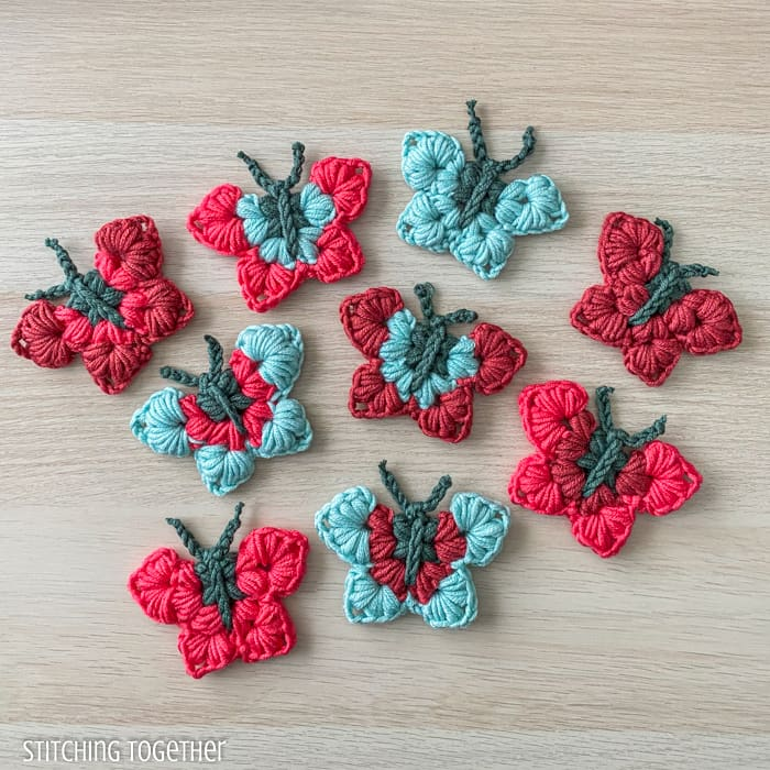 colorful butterflies that are crocheted
