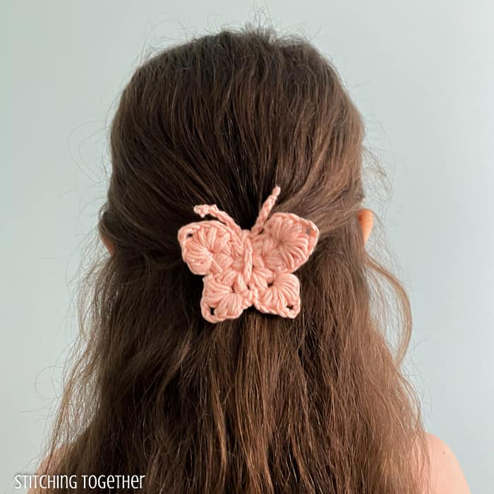 girl with a crochet butterfly barrette in her hair