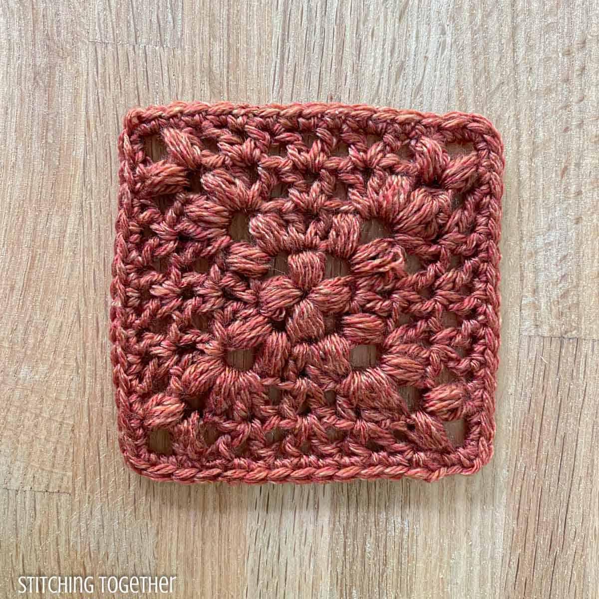 terracotta granny square crochet with open stitches
