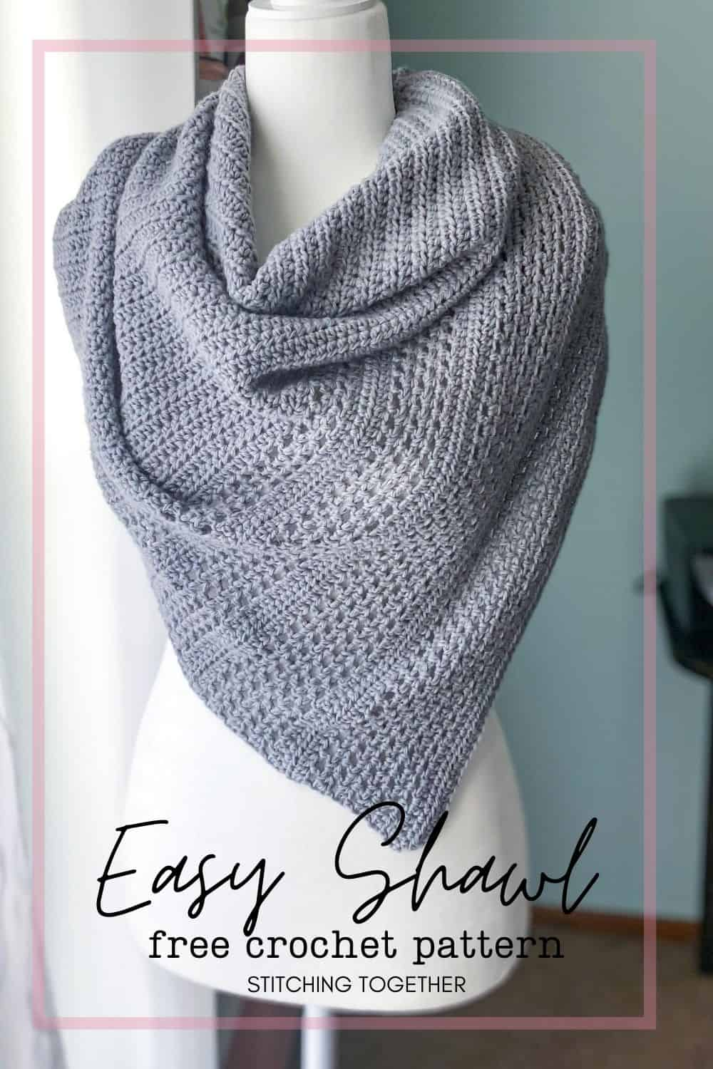 mannequin wearing gray crochet triangle shawl