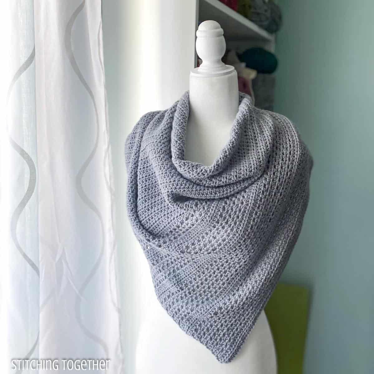 crochet shawl on a mannequin