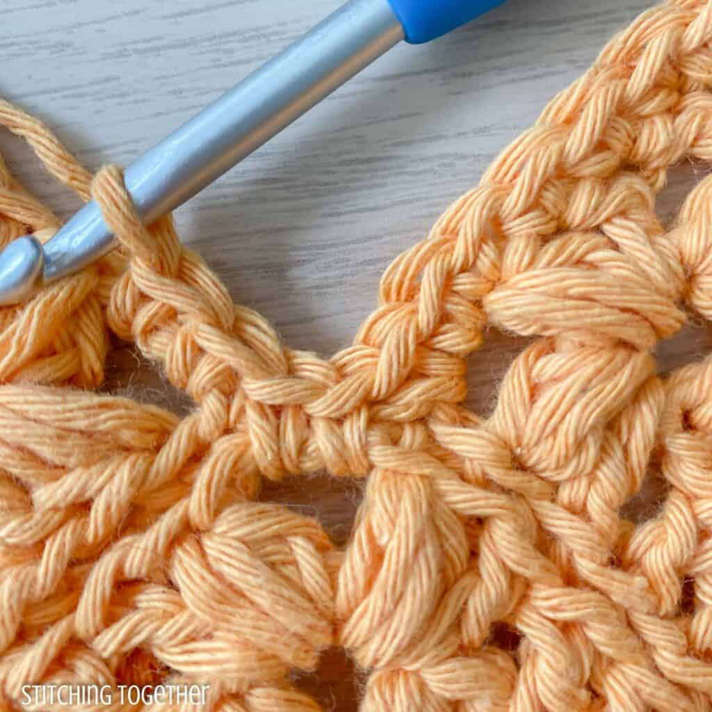 close up of crochet stitches showing where to place the stitches