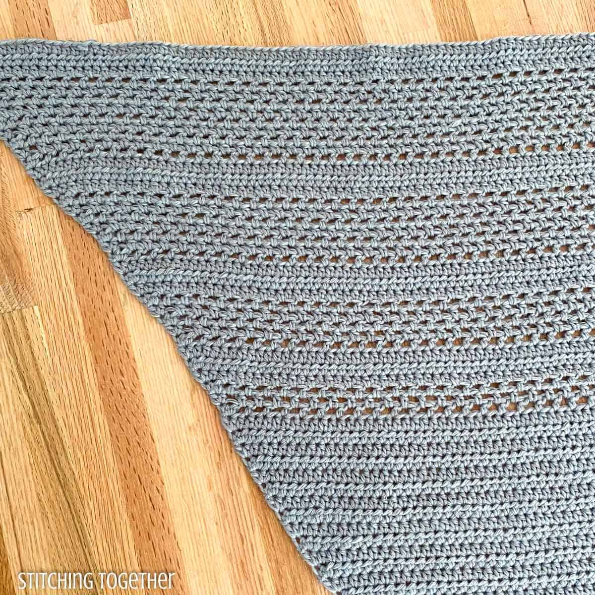 close up of crochet stitches in shawl