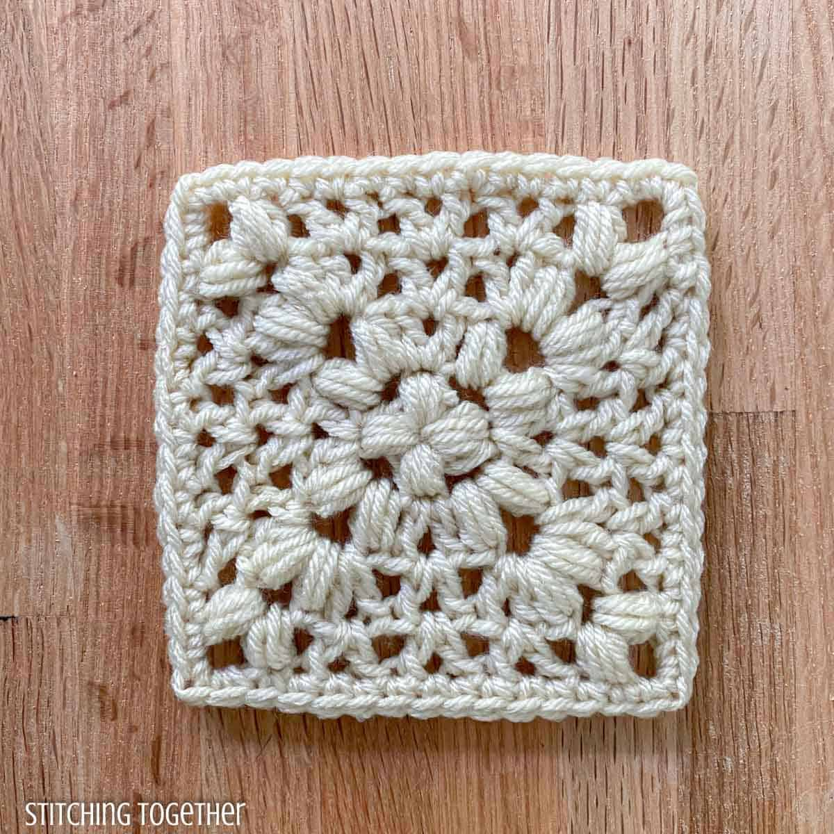 ivory crochet granny square with open stitches