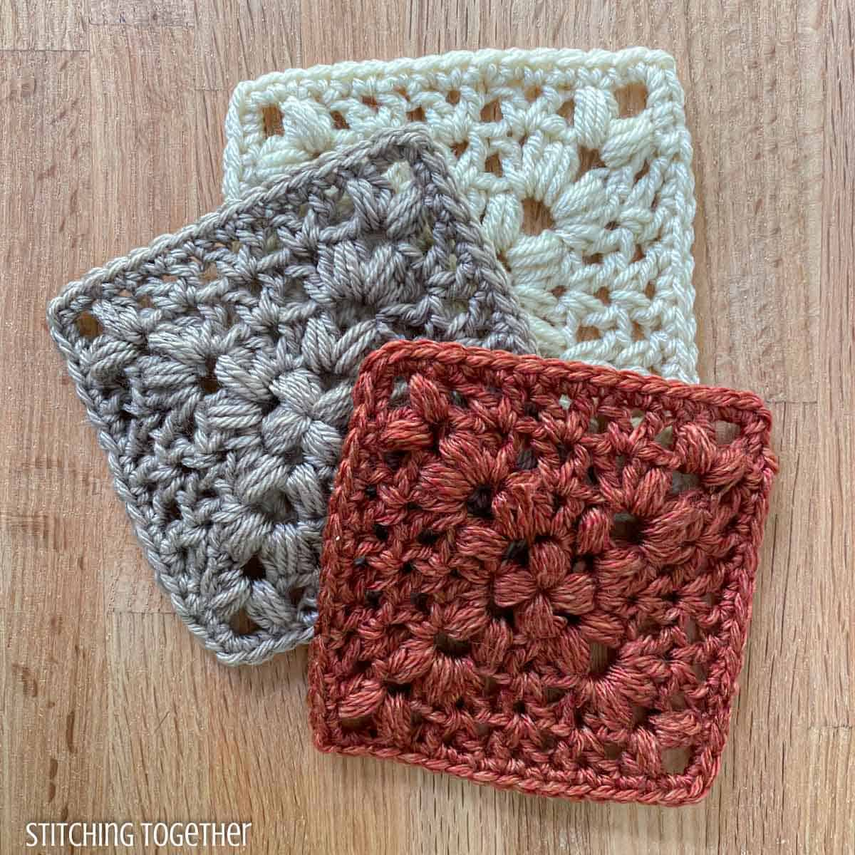 3 crochet granny squares messily stacked on top of each other