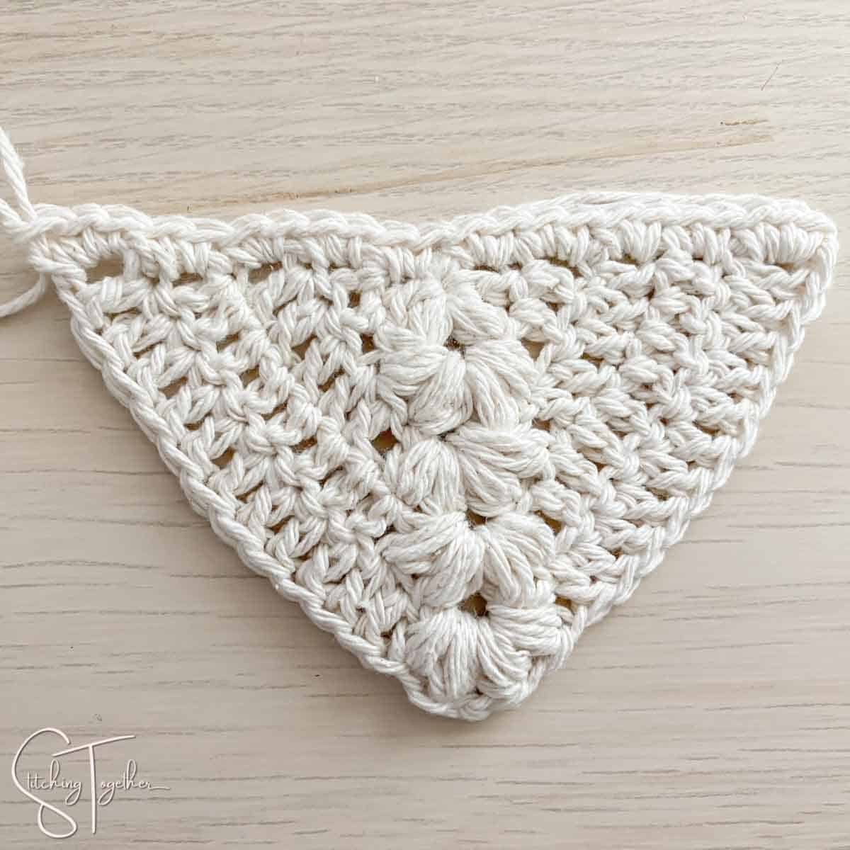 crochet triangle with puff stitches
