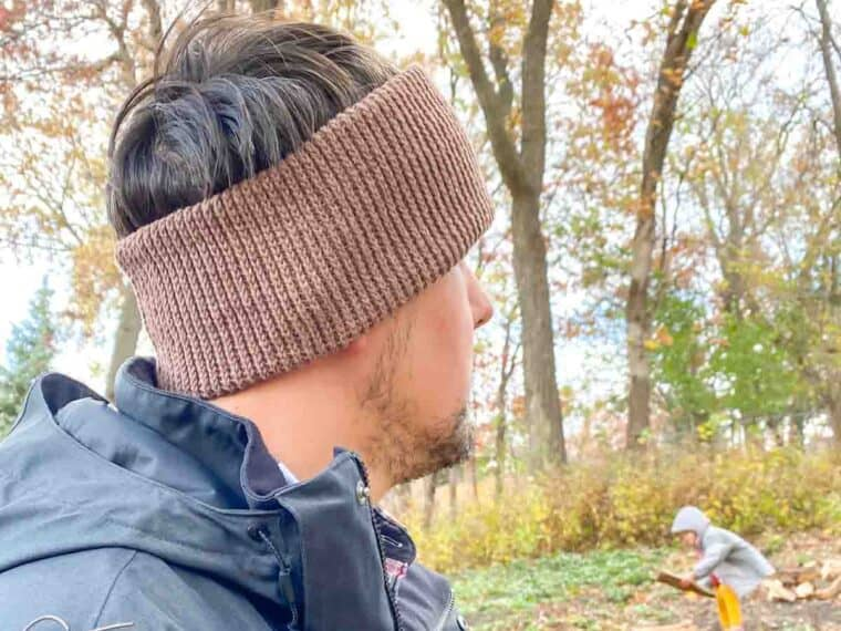 crochet ear warmer for a man being worn outdoors