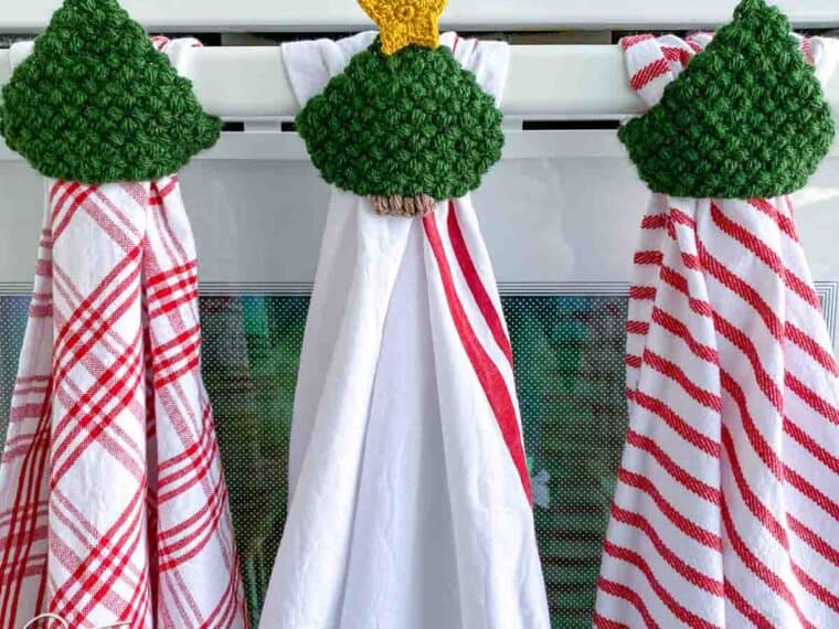 3 hanging Christmas dishtowels with crochet tree toppers
