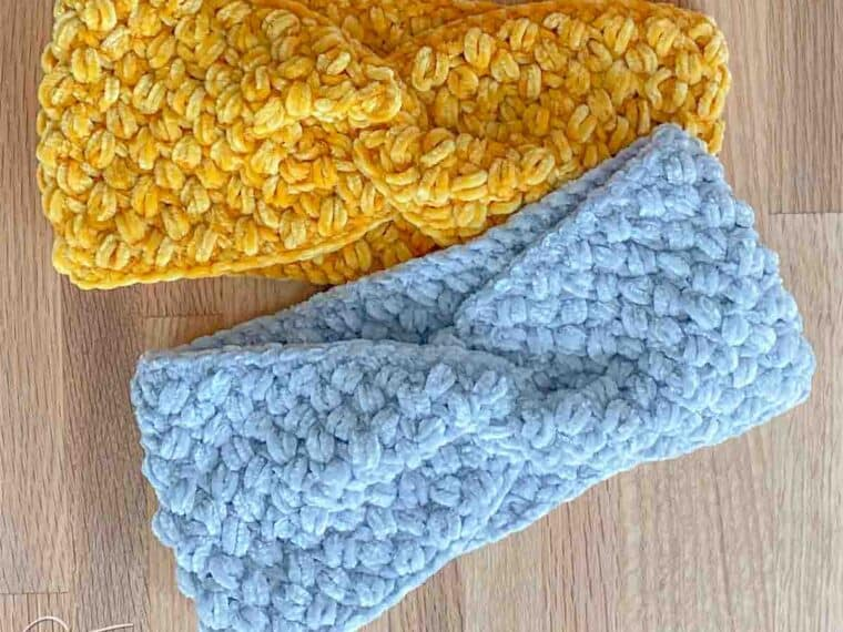 two crochet headbands with twists laying flat