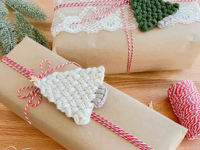 wrapped christmas gifts with Christmas Trees crocheted on the top