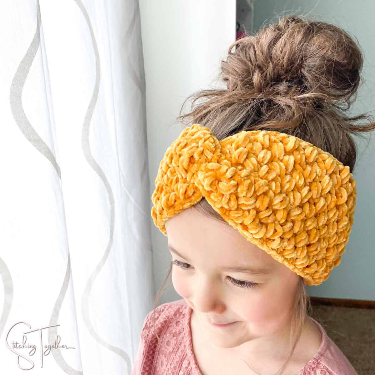 cute girl wearing a crochet twisted velvet headband