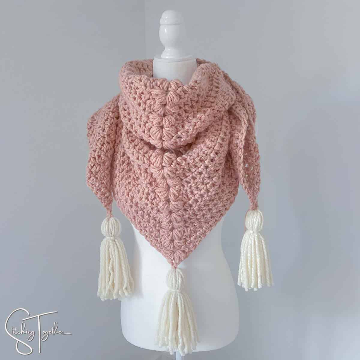 crochet chunky scarf on a mannequin