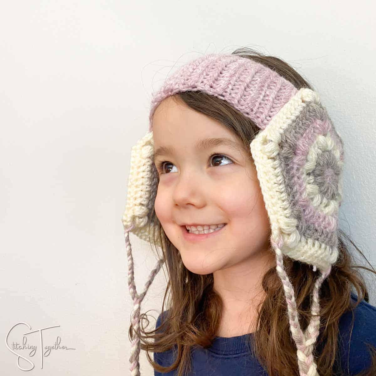 child wearing handmade crochet head warmer