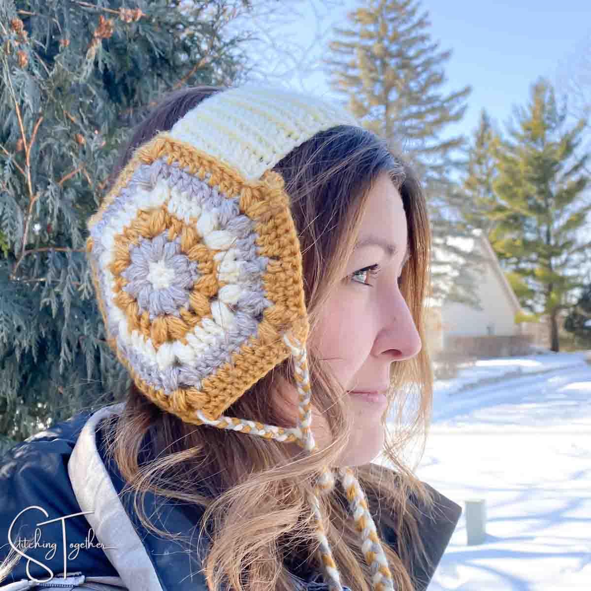 woman wearing crochet ear warmer with ear flaps