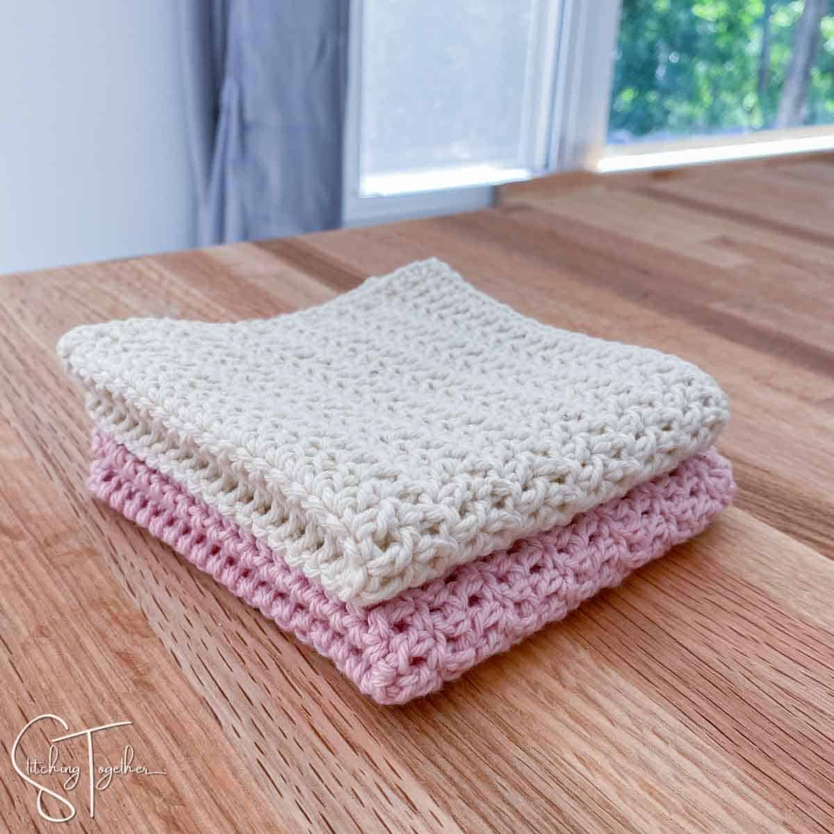 stack of two crochet dishcloths folded on a counter